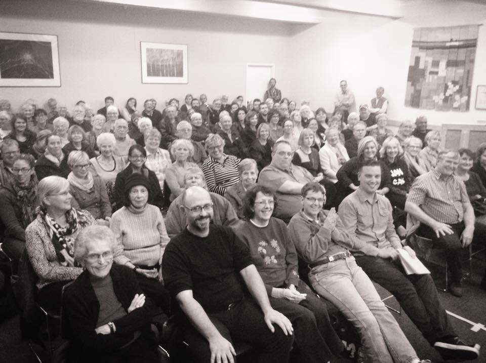 Smiling audience at Mudtown Records' All Candidates Forum on the Future of the Arts in the Owen Sound Economy.