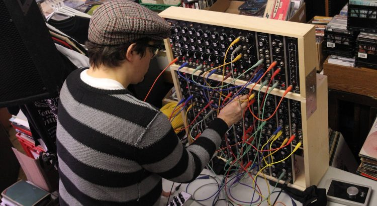 Audio engineer Tim Glasgow works with a modular synthesizer.